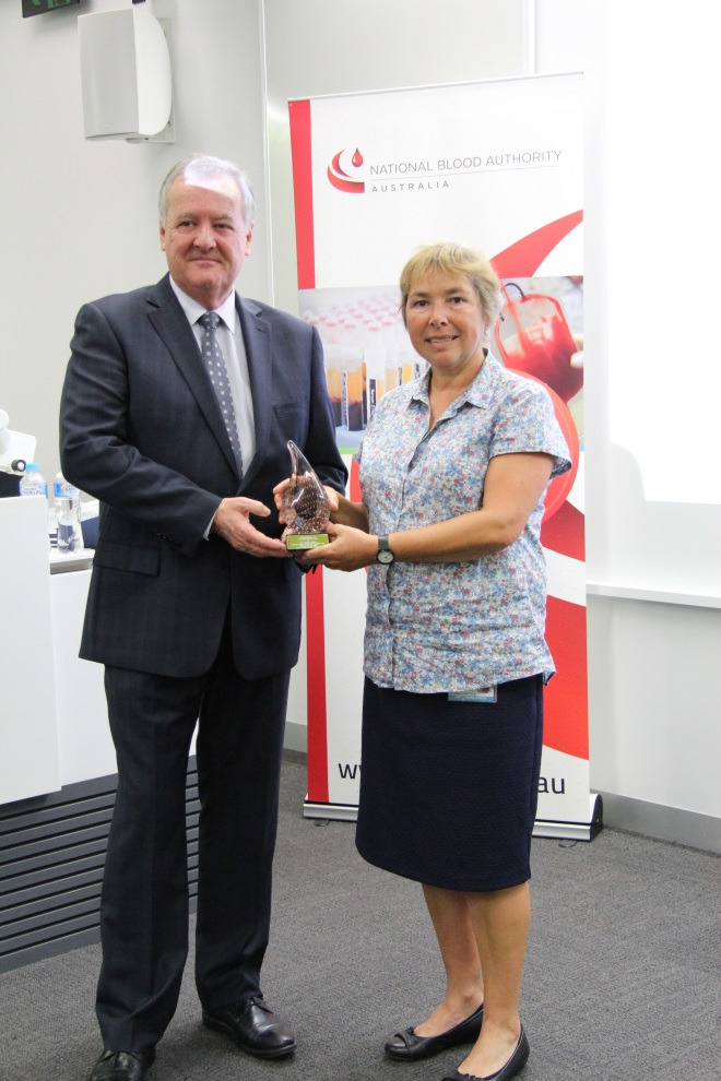 NBA Chief Executive, Mr John Cahill presents Ms Annette Le-Viellez a commemorative award for PathWest's one millionth order placed through BloodNet